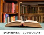 the book unfolded on the floor... | Shutterstock . vector #1044909145