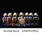 glass jars with the symbols of... | Shutterstock . vector #1044923902