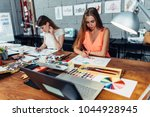 designers workspace. two female ... | Shutterstock . vector #1044928945