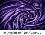 Small photo of Silk Cloth Swirl Spiral Background, Purple Swirled Fabric Knot, Abstract Satin Drapes