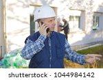 mature engineer talking on the...   Shutterstock . vector #1044984142