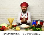 man with beard works with flour ...   Shutterstock . vector #1044988012