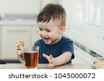 beautiful baby sitting in the... | Shutterstock . vector #1045000072