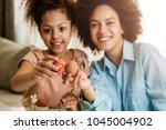 beautiful african american... | Shutterstock . vector #1045004902