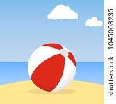 beach ball lying in the sand.... | Shutterstock .eps vector #1045008235