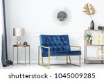 Blue Bench Between Gold Table...