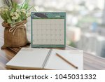 notebook with pencil diary on... | Shutterstock . vector #1045031332