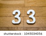 Small photo of Figure thirty-three on a wooden, parquet floor as a background.