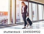 smiling female passenger... | Shutterstock . vector #1045034932