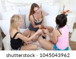 group of three cheerful female... | Shutterstock . vector #1045043962