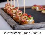 bruschetta on a wooden... | Shutterstock . vector #1045070935
