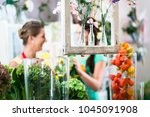 florist woman and customer in... | Shutterstock . vector #1045091908