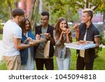 take a bite of pizza. young... | Shutterstock . vector #1045094818