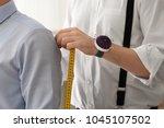 tailor taking man's... | Shutterstock . vector #1045107502