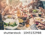 group of people having meal... | Shutterstock . vector #1045152988