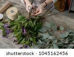 the hands of florist against... | Shutterstock . vector #1045162456