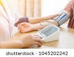 doctor and patient measuring... | Shutterstock . vector #1045202242