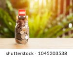 car model on coins in glass... | Shutterstock . vector #1045203538