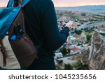 a tourist with a backpack on... | Shutterstock . vector #1045235656