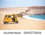 tuk tuk mototaxi in paracas... | Shutterstock . vector #1045273636