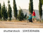 running mother with child in... | Shutterstock . vector #1045304686