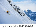 a man is skiing down the hill... | Shutterstock . vector #1045318402