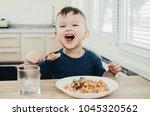beautiful cute baby eats rice... | Shutterstock . vector #1045320562