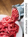 Small photo of Meat grinder - process of grinding meat. Beef red mince in mincing-machine.