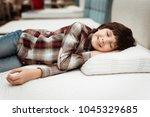 joyful boy enjoying softness of ... | Shutterstock . vector #1045329685
