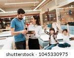 lovely girl consultant with... | Shutterstock . vector #1045330975