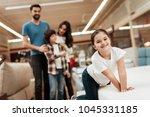 blissful family buys new... | Shutterstock . vector #1045331185