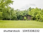 grassy yard of a private house  | Shutterstock . vector #1045338232