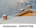 Chimney Pot On A Snow Covered...