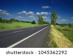 empty asphalt road in a rural... | Shutterstock . vector #1045362292