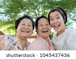 selfie senior woman with... | Shutterstock . vector #1045437436