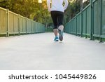 young fitness woman legs... | Shutterstock . vector #1045449826