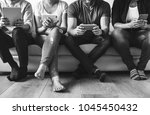 group of diverse people using... | Shutterstock . vector #1045450432