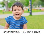 smiling little latin boy... | Shutterstock . vector #1045461025