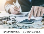 accountant working on desk in... | Shutterstock . vector #1045473466