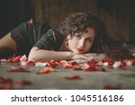 beautiful girl. rose petals.... | Shutterstock . vector #1045516186