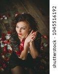 beautiful girl. rose petals.... | Shutterstock . vector #1045516192