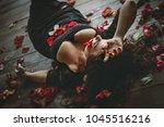beautiful girl. rose petals.... | Shutterstock . vector #1045516216