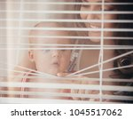 woman with child smile at... | Shutterstock . vector #1045517062
