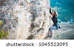 The Girl Climbs The Rock. The...