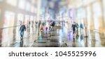 people walking on rainy city... | Shutterstock . vector #1045525996