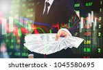businessman holding money us... | Shutterstock . vector #1045580695