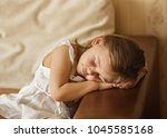 the little pretty girl fell... | Shutterstock . vector #1045585168