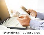 businessman do online shopping... | Shutterstock . vector #1045594708