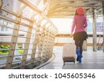 woman traveler with travel bag... | Shutterstock . vector #1045605346