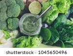 green smoothie in mason jar... | Shutterstock . vector #1045650496